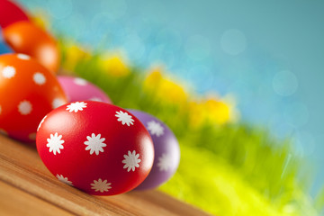 Colored Easter eggs on blue background