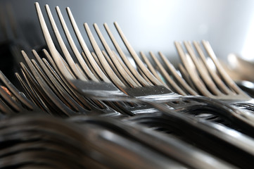 Forks arranged in series on the kitchen table.