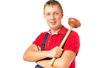 male worker in overalls with a plunger