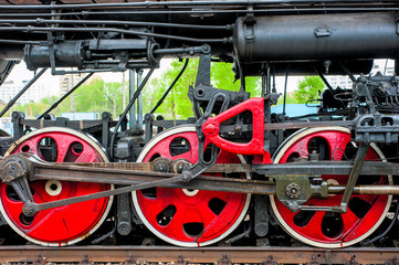 wheel steam locomotive close up on the rails