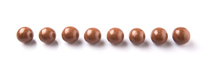 Chocolate balls with over white background