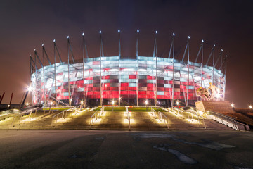 National Stadium in Warsaw illuminated at night, Poland