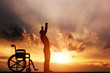 Leinwanddruck Bild - A disabled man standing up from wheelchair. Medical miracle.