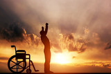 A disabled man standing up from wheelchair. Medical miracle.