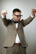 Confident nerd in eyeglasses and bow tie enjoying success