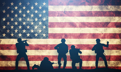 Soldiers in assault on USA flag. American army, military
