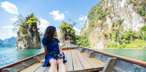 Girl sitting on longtail boat Thailand