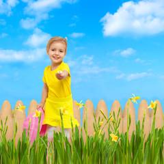 child giving flower sky blue summer garden