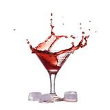 Red wine make splash into glass near ice cubes