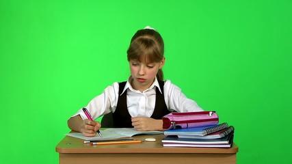 Schoolchild in classroom. Chroma key.