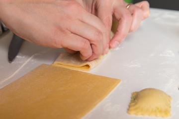 Handmade ravioli stuffed with cheese and spinach