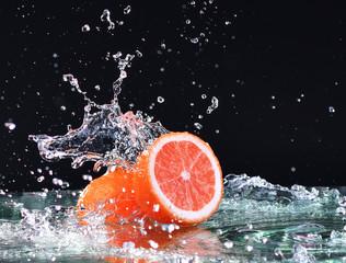 Macro water splash on grapefruit. Water drops