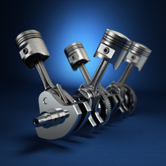 V4 engine pistons and cog on blue background.