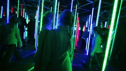 Little girl walks through labyrinth illuminated