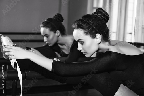ballerina girl in sportive clothes posing in dancing hall - 80197753