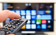 Smart tv and hand pressing remote control - 80198364
