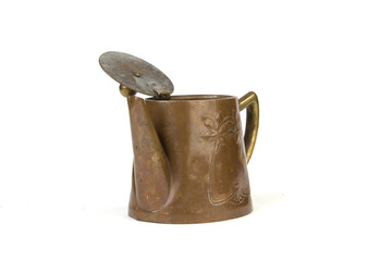 Antique copper teapot on white