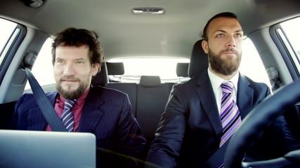 Handsome happy smiling business men in car