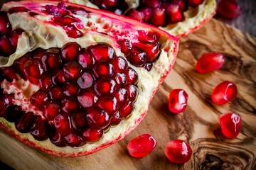 Pomegranate open with seeds closeup