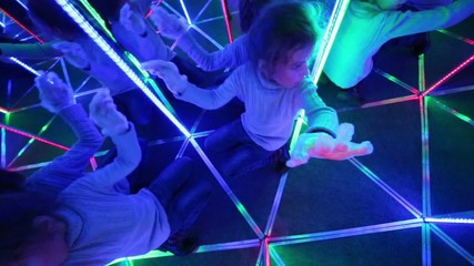 girl gets up from floor, searches pass out of mirror labyrinth