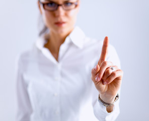 Woman touching an imaginary screen with her finger