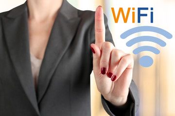 "Businesswoman  touching a  word ""Wi Fi """