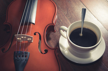Vintage filtered coffee cup with violin.