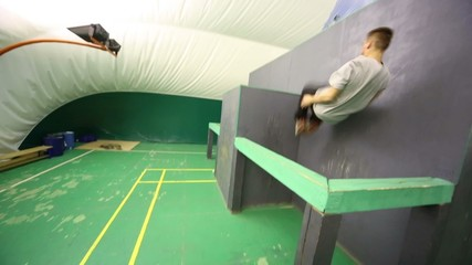 man does a somersault and run on the place for parkour training
