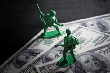 Soldier toys on money.