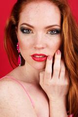 Beautiful redheaded girl with fashion makeup