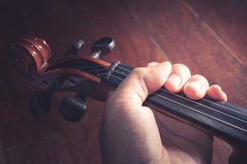 Violin in Violinist 's hand,vintage filtered.