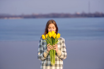 the girl with a tulip is situated on the bank of the river