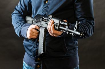 terrorist holding kalashnikov rifle