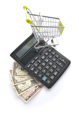 American dollars, calculator and grocery cart..