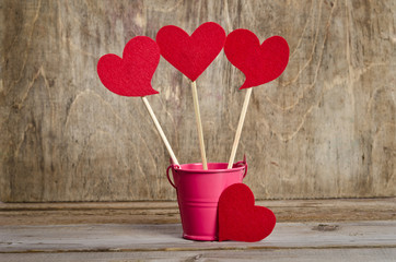 handmade skewers with cloth hearts for celebration  on wooden ba