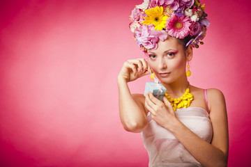 Spring girl with jewelry gift box and flowers hair