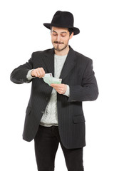 jew stingy man counts his money on white background