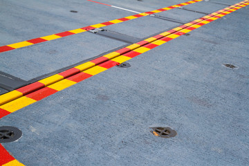 Red yellow line on the steel floor.