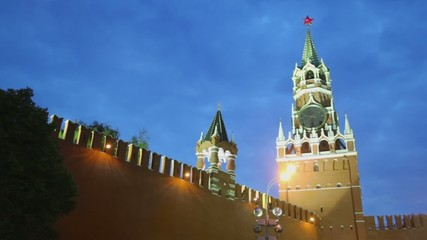 Kremlin wall with Tsarskaja Bashnja near Spasskaya tower with thirty eight minutes past nine on clock in Moscow