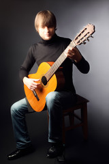 Acoustic guitar player classical guitarist