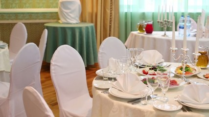 Tables in restaurant decorated for wedding celebration