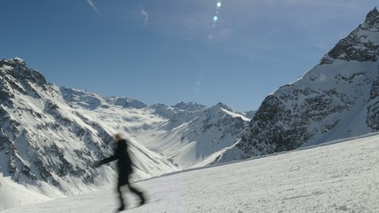 Skier and snowboarder piste mountain massiv background