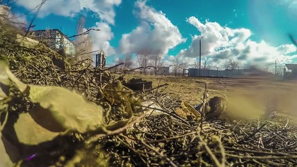 dry grass and leaves dirty ground Russian blue sky with clouds