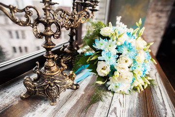 beautiful wedding bouquet on a wooden table with vintage