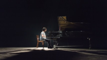Man playing piano on stage