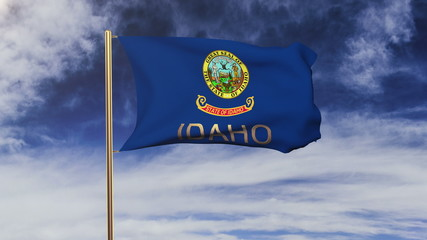 idaho flag with title waving in the wind. Looping sun rises