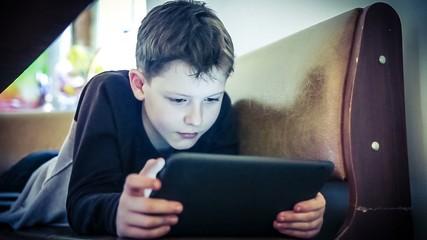 teenager boy plays in tablet color cross process instagram hd