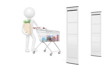 Kunde mit Einkaufswagen vor Warensicherung