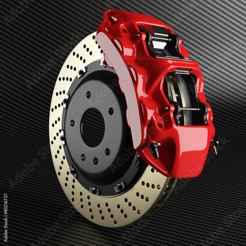 Automobile brake disk and red caliper on carbon background - 80216737