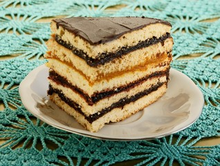 honey cake as layer-cake with jam filling